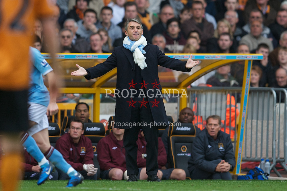 WOLVERHAMPTON, ENGLAND - Saturday, October 30, 2010: Manchester City's manager Roberto Mancini urges his side on against Wolverhampton Wanderers during the Premiership match at Molineux. (Pic by: David Rawcliffe/Propaganda)