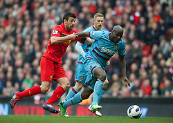 07.04.2013, Anfield, Liverpool, ENG, Premier League, FC Liverpool vs West Ham United, 32. Runde, im Bild Liverpool's Jose Enrique in action against West Ham United's Guy Demel during during the English Premier League 32th round match between Liverpool FC and West Ham United FC at Anfield, Liverpool, Great Britain on 2013/04/07. EXPA Pictures © 2013, PhotoCredit: EXPA/ Propagandaphoto/ David Rawcliffe..***** ATTENTION - OUT OF ENG, GBR, UK *****