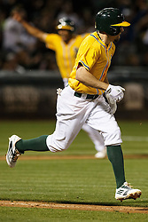 OAKLAND, CA - JUNE 17:  Billy Burns #1 of the Oakland Athletics runs to first base after driving home Marcus Semien (back) for a walk off single during the ninth inning against the Los Angeles Angels of Anaheim at the Oakland Coliseum on June 17, 2016 in Oakland, California. The Oakland Athletics defeated the Los Angeles Angels of Anaheim 3-2. (Photo by Jason O. Watson/Getty Images) *** Local Caption *** Billy Burns; Marcus Semien