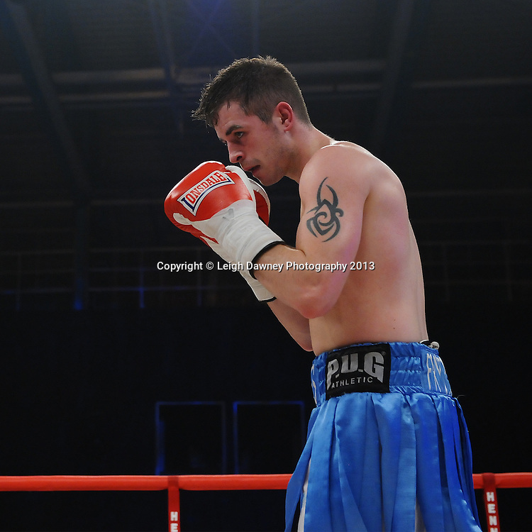 James Fryers defeats Michael Mooney in a Lightweight contest on 15th March 2014 at the Rivermead Leisure Centre, Reading, Berkshire. Promoted by Hennessy Sports. © Leigh Dawney Photography 2014.