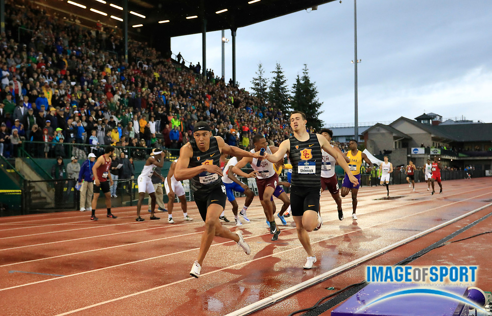 Jun 8, 2018; Eugene, OR, USA; Michael Norman takes the handoff from Zach Shinnick on the acnhor leg of the Southern California Trojans 4 x 400m relay that won in a collegiate record 2:59.00 during the NCAA Track and Field championships at Hayward Field.