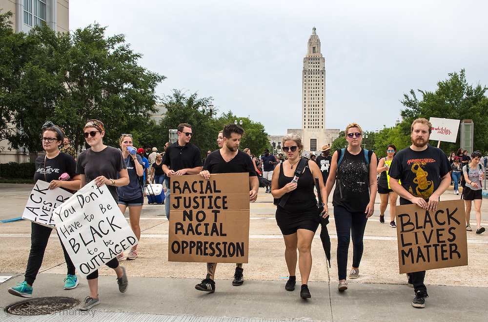 Protesters march away from the state capitol in Baton Rouge on Sunday, July 10, 2016, days following the Alton Sterling shooting.