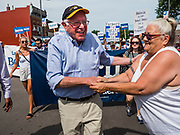 04 JULY 2019 - SLATER, IOWA: Senator BERNIE SANDERS (Ind-VT) greets supporters while he marches in the 4th of the July parade in Slater, IA. Sen. Sanders marched in the 4th of July parade in Slater to support his bid to be the Democratic nominee for the US presidency in 2020. Iowa holds the first presidential selection event of the 2020 election cycle. The Iowa caucuses are on Feb. 3, 2020.         PHOTO BY JACK KURTZ