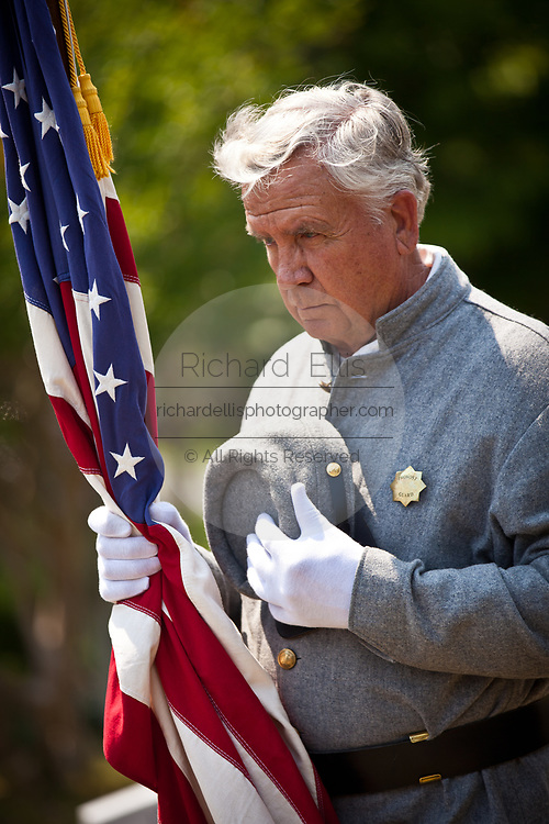 A Confederate Civil War re-enactor stands for a moment at Magnolia Cemetery to mark Confederate Memorial Day May 10, 2011 in Charleston, South Carolina.  South Carolina is one of three states that marks the day as a public holiday.
