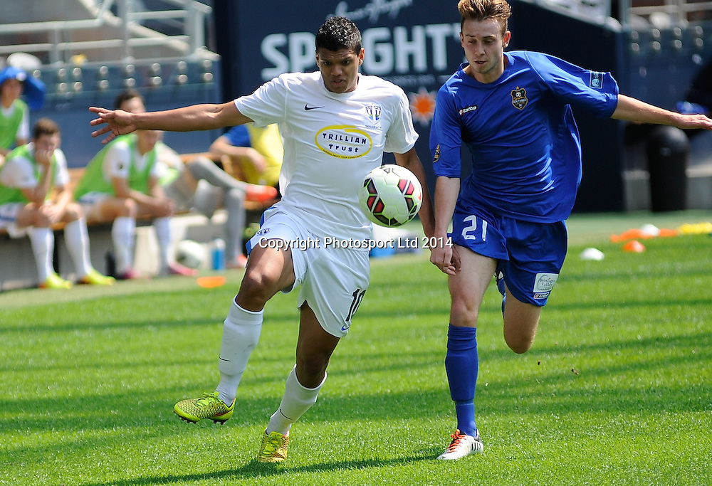 Ryan de Vries of Auckland & Nick Hindson of Southern in action during the ASB Football Premiership, Southern v Auckland, 25 October 2014, Forsyth Barr Stadium Dunedin,  New Zealand. Photo: Richard Hood/photosport.co.nz