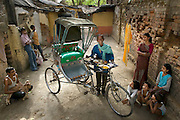 Munna Kailash, a bicycle rickshaw driver, with his typical day's worth of food outside the small home that he and his wife Meera share with their children in Varanasi?in India's Uttar Pradesh province. (From the book What I Eat: Around the World in 80 Diets.) The caloric value of his typical day's worth of food in the month of April was 2400 kcals. He is 45 years old; 5 feet, 6 inches; and 106 pounds. When he comes home for lunch he normally drinks a cup of tea, takes a short nap, and then heads back out into the steamy heat to find other patrons to cart from one location to the next, a job he does seven days a week.  MODEL RELEASED.