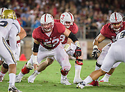PALO ALTO, CA - OCTOBER 15:  Graham Shuler #52 of the Stanford Cardinal plays in a PAC-12 football game against the UCLA Bruins on October 15, 2015 at Stanford Stadium on the campus of Stanford University in Palo Alto, California.  Visible behind Shuler is Stanford quarterback Kevin Hogan #8, and at right is Joshua Garnett #51.  (Photo by David Madison/Getty Images) *** Local Caption *** Graham Shuler