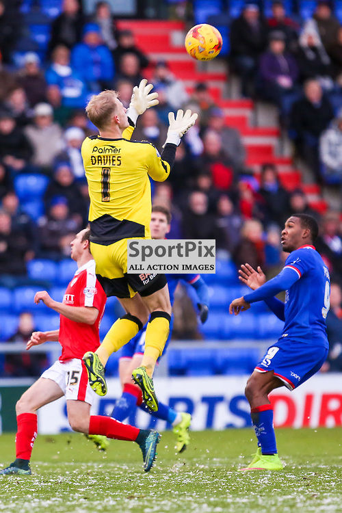Goalkeeper Adam Davies of Barnsley in action with Dominic Poleon of Oldham Athletic during Oldham v Barnsley, Sky Bet League One, 21 November 2015,  (c) Jackie Meredith/SportPix.org.uk