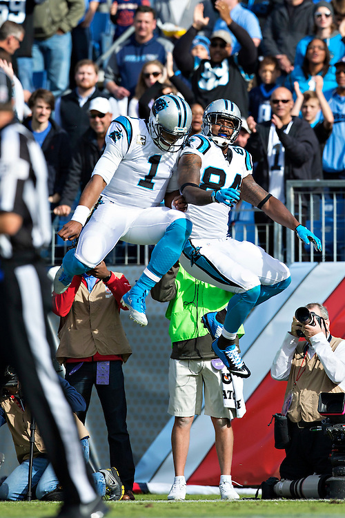 NASHVILLE, TN - NOVEMBER 15:  Cam Newton #1 and Ed Dickson #84 of the Carolina Panthers body bump after scoring a touchdown against the Tennessee Titans at Nissan Stadium on November 15, 2015 in Nashville, Tennessee.  (Photo by Wesley Hitt/Getty Images) *** Local Caption *** Cam Newton; Ed Dickson