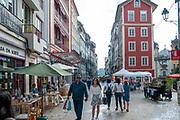 Pedestrian street of Rua Visconde da Luz in Coimbra, Portugal with an arts and crafts fair