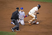Chicago Cubs second baseman Javier Baez (9) tags San Francisco Giants center fielder Denard Span (2) out at second base during Game 4 of the NLDS at AT&T Park in San Francisco, Calif., on October 11, 2016. (Stan Olszewski/Special to S.F. Examiner)