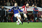 Cardiff City striker, Lex Immers (27) shielding the ball from Brentford midfielder, Alan McCormack (12) during the Sky Bet Championship match between Brentford and Cardiff City at Griffin Park, London, England on 19 April 2016. Photo by Matthew Redman.