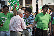 Hiroya Masuda, a major candidate for Tokyo gubernatorial election shakes hands with supporters in Ginza,Tokyo. The former internal affairs minister has the backing of the Liberal Democratic Party, Komeito and the Party for the Japanese Kokoro in the July 31 election. 18/07/2016-Tokyo, JAPAN