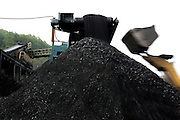 The coal washed at Unity Mine facilities is being loaded onto trucks and cargo trains to be sent to power stations around the United Kingdom from the Unity Mine complex, on Wednesday, Apr. 11, 2007, in Cwmgwrach, Vale of Neath, South Wales. The time is ripe again for an unexpected revival of the coal industry in the Vale of Neath due to the increasing prize and diminishing reserves of oil and gas, the uncertainties of renewable energy sources, and the technological advancement in producing energy from coal while limiting emissions of pollutants, has created the basis for valuable investment opportunities and a possible alternative to the latest energy crisis. Unity Mine, in particular, has started a pioneering effort to revive the coal industry in the area, reopening after more than 8 years with the intent of exploiting the large resources still buried underground. Coal could be then answer to both, access to cheaper and paradoxically greener energy and a better and safer choice than nuclear energy as a major supply for the decades to come. It is estimated that coal reserves in Wales amount to over 250 million tonnes, or the equivalent of at least 50 years of energy supply, while the worldwide total coal could last for over 200 years as a viable resource compared to only a few decades of oil and natural gas.