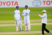Hampshire batsmen Ryan McLaren and James Tomlinson standing in the middle of the wicket as the umpires discuss the low light during the Specsavers County Champ Div 1 match between Hampshire County Cricket Club and Warwickshire County Cricket Club at the Ageas Bowl, Southampton, United Kingdom on 10 April 2016. Photo by Graham Hunt.