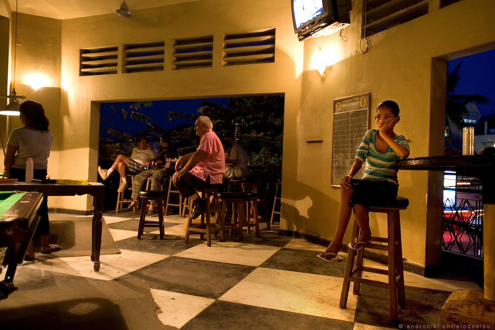 "Child trafficking and prostitution in Cambodia.Bar ""Walkabout"" in Phnom Penh is one of the bars where young and many times underaged prostitutes go to pick up foreign clients. The bar also offers rooms for its customers on the upper floor."