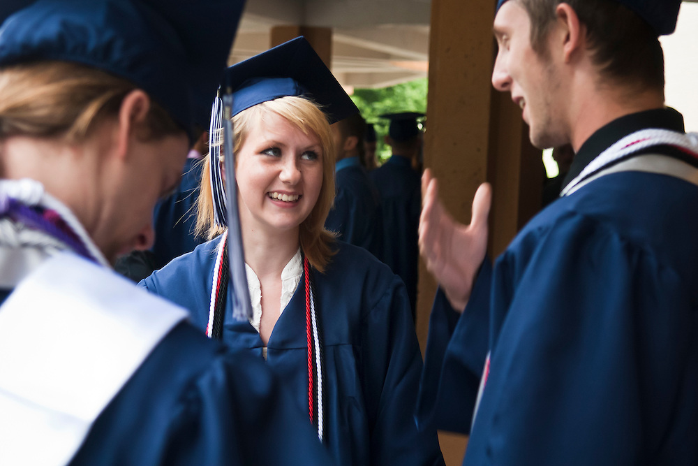 Lathan Goumas | MLive.com..Ashley Budziak, 18, talks with fellow graduates before the 2012 Elisabeth Ann Johnson High School, of Mt. Morris, commencement ceremony on Thursday May 31, 2012 at the Whiting Theater in Flint, Mich.