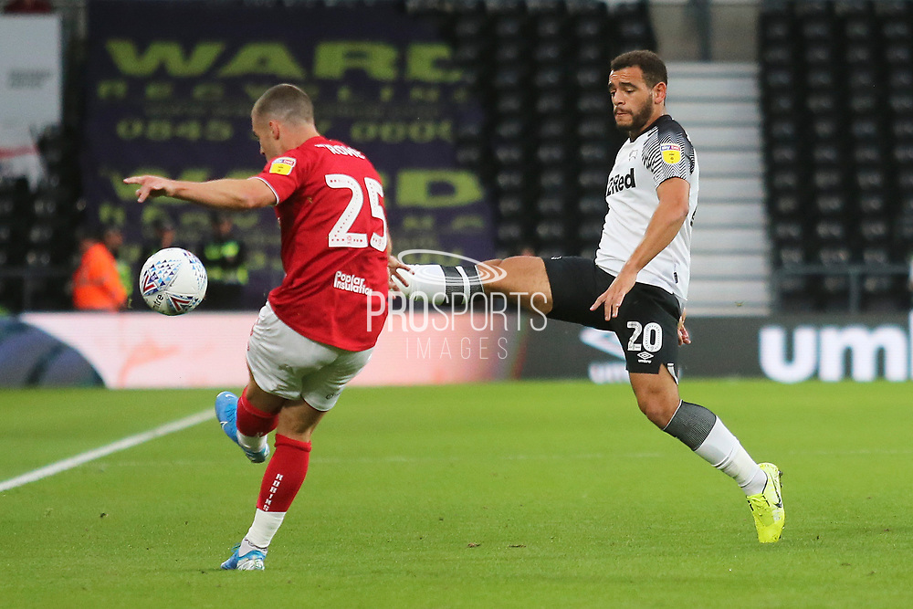 Derby County forward Mason Bennett (20) attempts tp cut out a pass from Bristol City midfielder Tommy Rowe (25) during the EFL Sky Bet Championship match between Derby County and Bristol City at the Pride Park, Derby, England on 20 August 2019.