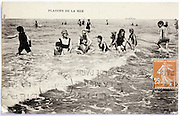 photo postcard with people having fun in the sea 1920s