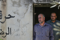 Two relatives of the Dawabsheh family standing in the doorway of the house which was firebombed by Israeli settlers and the family killed. From a series of photos commissioned by  British NGO, Medical Aid for Palestinians (MAP).