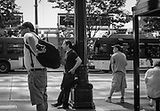 2013 June 30 - Men wait at a bus stop along 3rd Avenue, Seattle, WA. By Richard Walker