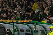 Celtic fans look on as the Referee watches the VAR monitor behind the dugout during the Europa League match between Celtic and FC Copenhagen at Celtic Park, Glasgow, Scotland on 27 February 2020.
