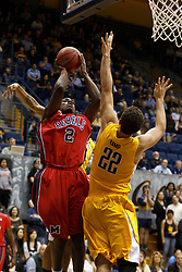 March 16, 2011; Berkeley, CA, USA;  Mississippi Rebels forward Reginald Buckner (2) shoots over California Golden Bears forward Harper Kamp (22) during the first half of the first round of the National Invitation Tournament at Haas Pavilion.  California defeated Mississippi 77-74.