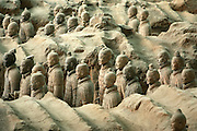 The Terracotta army stands in Xi' An, Shaanxi province, China, on April 14, 2006. The Terracotta Army contains the Terracotta Warriors and Horses of Qin Shi Huang the First Emperor of China. Dating from 210 BC, the terracotta figures were discovered in 1974 by several local farmers near the Mausoleum of the First Qin Emperor. The Terracotta Army includes over 8,000 soldiers, 130 chariots with 520 horses and 150 cavalry horses, the majority of which are still buried in the pits. Photo by Lucas Schifres/Pictobank
