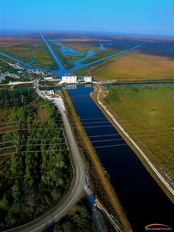 Aerial view of C-11 Canal as it flows west into the Everglades past drainage control