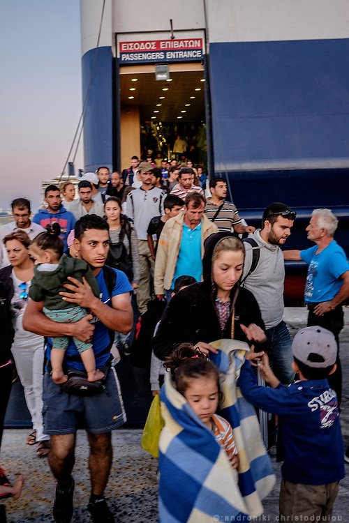 Refugees disembarking a ferry that brought them from esvos island to Piraeus port near Athens.