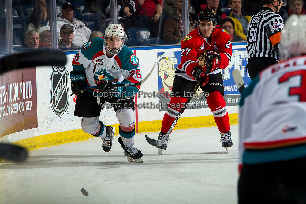 KELOWNA, CANADA - MARCH 3:  Jared Freadrich #27 of the Portland Winterhawks clears the puck from Liam Kindree #26 of the Kelowna Rockets during second period on March 3, 2019 at Prospera Place in Kelowna, British Columbia, Canada.  (Photo by Marissa Baecker/Shoot the Breeze)