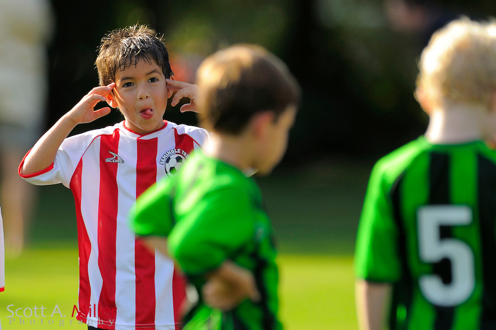 A player makes faces at his opponent during a youth soccer game in the Seminole Youth Soccer League...©2008 Scott A. Miller