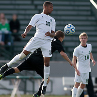 Slippery Rock's Anthony Jack (10) heads the ball with Alex LaFaver (24) defending during a second round playoff match at Mihalik-Thompson Stadium on November 16, 2013.