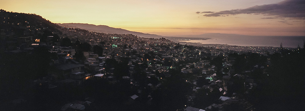 The sun sets over the Tapis Rouge neighborhood on Friday, December 19, 2014 in Port-au-Prince, Haiti.
