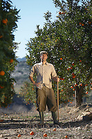 Farmer in orchard