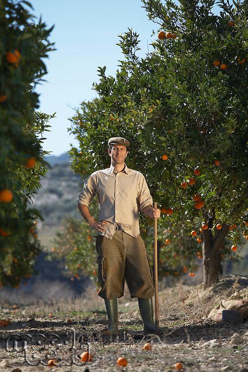 Farmer in orchard