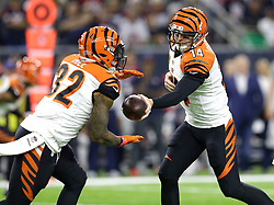 Cincinnati Bengals quarterback Andy Dalton (14) hands the ball off to running back Jeremy Hill (32) during the first half of an NFL football game against the Houston Texans Saturday, Dec. 24, 2016, in Houston. (AP Photo/Sam Craft)
