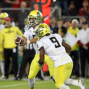 Oregon QB Marcus Mariota, goes through option reads as he prepares to hand the ball off to his running back, Byron Marshall.  The Stanford Cardinals upset the Oregon Ducks 26-20 at Stanford Stadium.  11/7/13, 3:30pm, Photo by Barry Markowitz