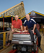 Baseball legend Nolan Ryan and Dallas Cowboys football tycoon Jerry Jones sit atop the Texas Giant roller coaster at Six Flags Over Texas. Shot for the cover of the Arlington, Texas Visitors Guide.