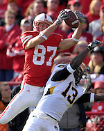 University of Nebraska wide receiver Nate Swift (87) pull in a 56-yard pass over Missouri defensive back Cornelius Brown (13) in the fourth quarter at Memorial Stadium in Lincoln, Nebraska, November 4, 2006.  The Huskers defeated the Tigers 34-20.<br />