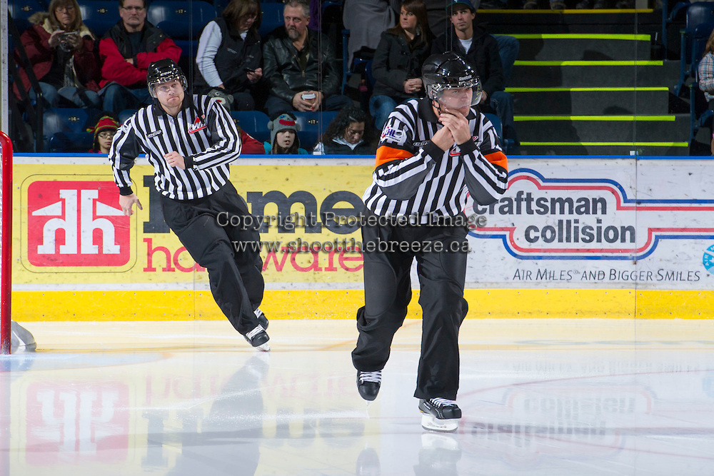 KELOWNA, CANADA - DECEMBER 8:  Reagan Vetter, referee and Alex Teichroeb, linesman, enter the ice as the Prince George Cougars visit the Kelowna Rockets on December 8, 2012 at Prospera Place in Kelowna, British Columbia, Canada (Photo by Marissa Baecker/Shoot the Breeze) *** Local Caption ***