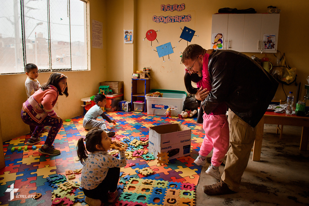 The Rev. Eddie Hosch, LCMS career missionary to Peru, says goodbye to children at Castillo Fuerte on Monday, Nov. 6, 2017, in the Chorrillos area of Lima, Peru.  LCMS Communications/Erik M. Lunsford