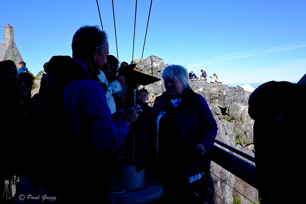 Cape Town, South Africa. Tourists enjoy the view from the top of Table Mountain.