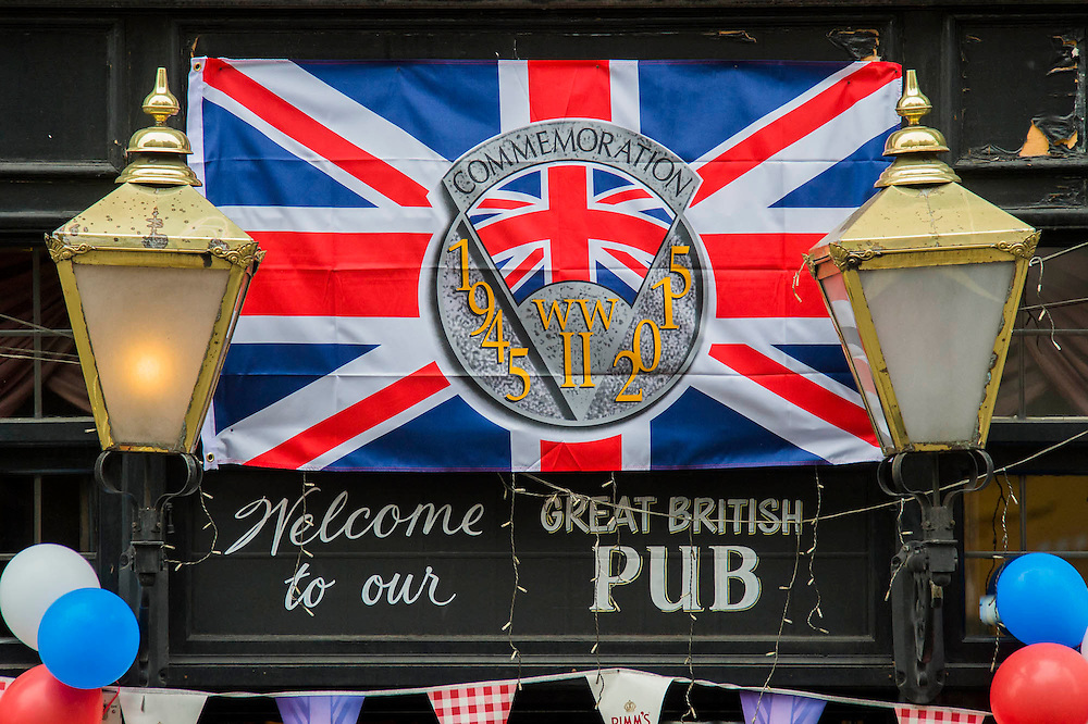 A Whitehall pub gets n the spirit. VE Day 70 commemorations - Three days of events in London and across the UK marking historic anniversary of end of the Second World War in Europe. Trafalgar Square, scene of jubilant celebrations marking the end of the Second World War in Europe on 8 May 1945, plays a central part in a host of national events, which include a Service of Remembrance at the Cenotaph, a concert in Horse Guards Parade, a Service of Thanksgiving at Westminster Abbey, a parade of Service personnel and veterans and a flypast.