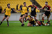 Alapati Leiua (Front C) of the Hurricanes is tackled by Tanerau Latimer of the Chiefs withe Chiefs Sam Cane (R and Ben Tameifuna (Back C) and Hurricanes' Jack Lam (Back CL) and Conrad Smith captain of the Hurricanes in support during a Super Rugby - Hurricanes v Chiefs match at the Westpac Stadium in Wellington on Saturday the 24th of May 2014. Photo by Marty Melville/www.Photosport.co.nz