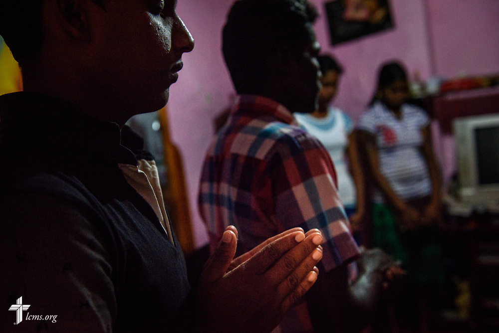 Church members in a home on the Eila rubber plantation in the Sabaragamuwa Province of Sri Lanka pray with their pastor, the Rev. P. Gnanakumar, and the Rev. Steven Mahlburg, LCMS career missionary to Sri Lanka (both not pictured), during a visitation on Saturday, Jan. 20, 2018. LCMS Communications/ Erik M. Lunsford