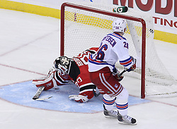 Mar 25, 2010; Newark, NJ, USA; New York Rangers center Erik Christensen (26) scores the game winning goal past New Jersey Devils goalie Martin Brodeur (30) during the overtime shootout at the Prudential Center. The Rangers won 4-3 in an overtime shootout.