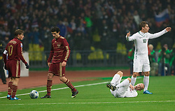 An incident when Andrej Arsavin (10) of Russia hit Miso Brecko (on the ground) of Slovenia at  FIFA World Cup Sout Africa 2010 Qualifying Play off match between Russia and Slovenia, on November 14, 2009, in Stadium Luzhniki, Moscow, Russia. Russia won 2:1. (Photo by Vid Ponikvar / Sportida)