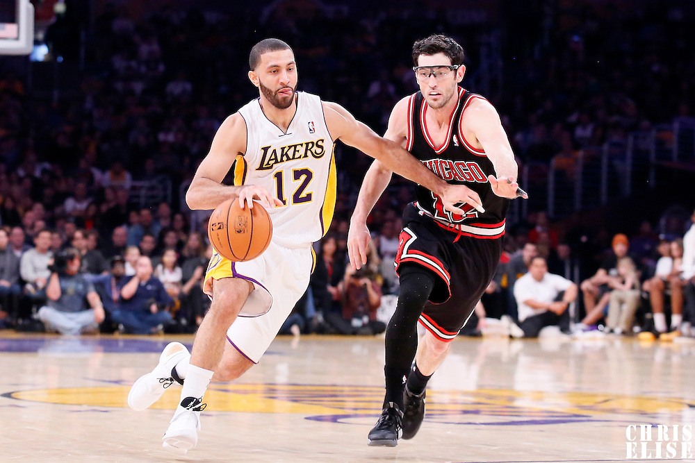 09 February 2014: Los Angeles Lakers point guard Kendall Marshall (12) drives past Chicago Bulls shooting guard Kirk Hinrich (12) during the Chicago Bulls 92-86 victory over the Los Angeles Lakers at the Staples Center, Los Angeles, California, USA.