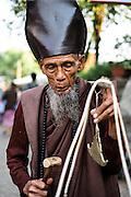 Hermit monk waiting for alms at Kyaiktiyo Pagoda (Golden rock)). Mon State, Myanmar